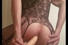 Sissy crossdresser toying with Ten inch sex-toy