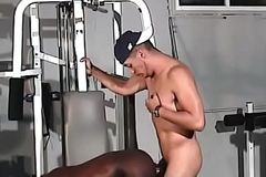 Black together with white gay hunks with fit bodies fuck in the gym