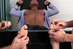 Dressy jock in suit loves getting his feet tickled by two dudes