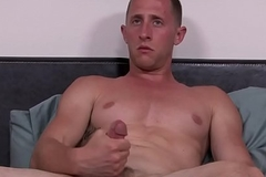 Athletic soldier stroking his massive cock