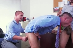 Office stud in T-shirt and tie receives spitroasted
